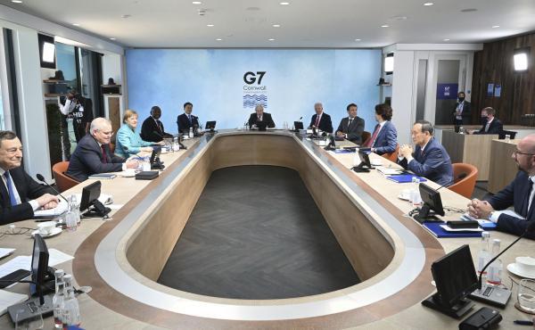 Leaders Boris Johnson of the U.K., center, with from left, Italy's Mario Draghi, Australia's Scott Morrison, Germany's Angela Merkel, South Africa's Cyril Ramaphosa, South Korea's Moon Jae-in, U.S.'s Joe Biden, France's Emmanuel Macron, Canada's Justin Tr