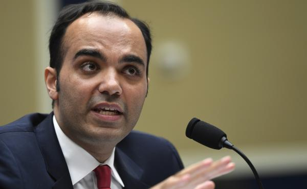 """Rohit Chopra, Biden's pick to run the Consumer Financial Protection Bureau, told lawmakers at a remote hearing, """"the financial lives of millions of Americans are in ruin."""" He's pictured here at a hearing in 2019."""