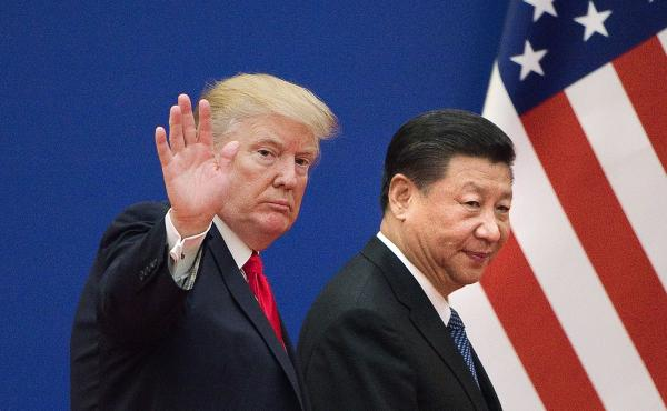 President Trump and China's leader Xi Jinping leave a business leaders event in Beijing in 2017. Relations involving trade and other areas between the two countries have deteriorated.