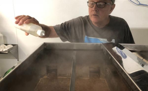 Neil McLeod, owner of Neil's Bigleaf Maple Syrup farm, keeps a close eye on his reducing sap for out of control foaming.