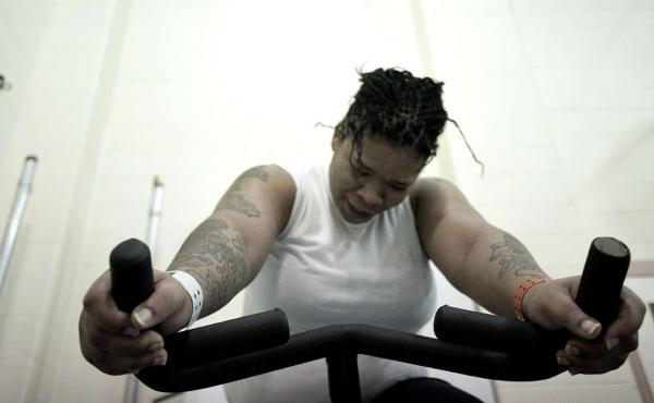 Leahya Ellis and other spinning class participants use exercise as a way to shake away stress, anger and depression.