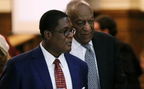 Comedian Bill Cosby walks with spokesman Andrew Wyatt during deliberations in Cosby's sexual assault trial earlier this month at the Montgomery County Courthouse in Norristown, Pa.