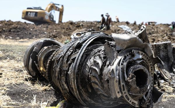 Debris from an Ethiopian Airlines Boeing 737 Max 8 jet sits in a field near Bishoftu, where the plane crashed after taking off from Ethiopia's capital city, Addis Ababa, on Sunday.
