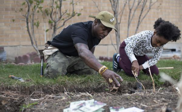 """Ietef """"DJ Cavem Moetavation"""" Vita plants seeds with daughter Libya LeaDonvita in the garden at their home outside Denver. Vita is among a growing list of Black gardening enthusiasts-turned-entrepreneurs across the country who've launched seed businesses d"""