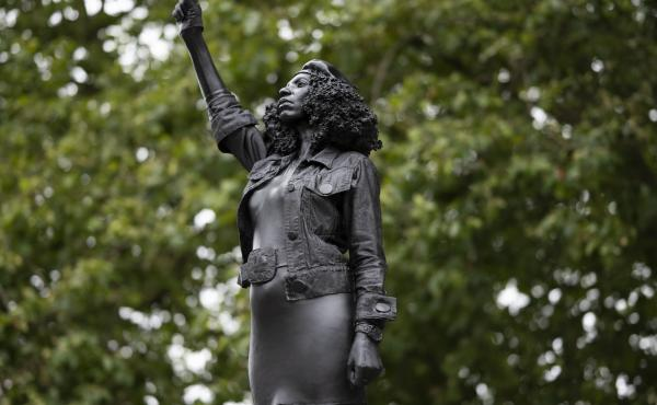 A new sculpture by local artist Marc Quinn, depicting Black Lives Matter protester Jen Reid, stands on the plinth where the Edward Colston statue used to rest in Bristol.