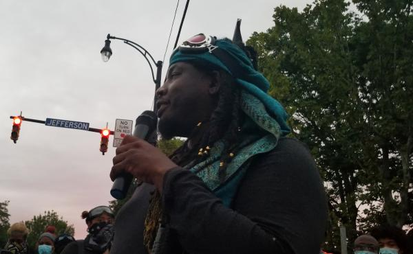 """Poet and activist Christopher Coles addresses a crowd in Rochester, N.Y. His message to white protesters is a reminder: """"For some of you all that come here, you come because it's an elective. We come because it's survival."""""""