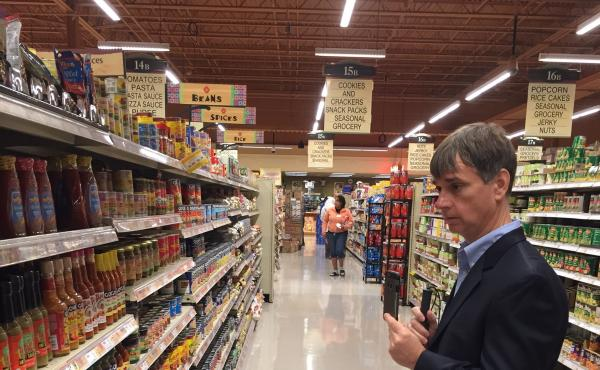 Gary Wagner, a blind Buffalo resident and subscriber to an app that connects him to a shopping assistant, looks for hot sauce at a Wegmans store in Amherst, New York.