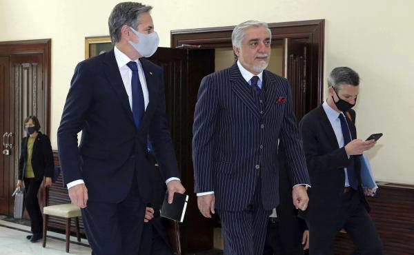 Abdullah Abdullah (center), chairman of the High Council for National Reconciliation, accompanies U.S. Secretary of State Antony Blinken at the Sapidar Palace in Kabul, Afghanistan, on Thursday.