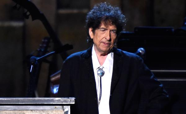Bob Dylan speaks onstage at the MusiCares 2015 Person Of The Year Gala in Los Angeles. Dylan was awarded the Nobel Prize in literature in October, though he has not yet accepted it. The Swedish Academy has announced he plans to do so this weekend in Stock