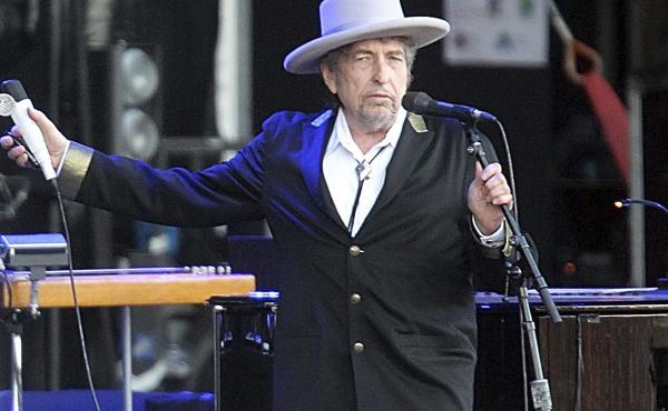 "Bob Dylan, seen performing in 2012, told the Swedish Academy that he had ""pre-existing commitments."""