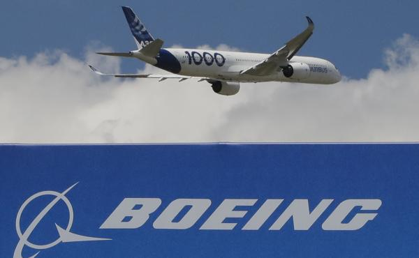 An Airbus A 350 - 1000 performs his demonstration flight at Paris Air Show, in Le Bourget, east of Paris, France, Monday, June 17, 2019. The world's aviation elite are gathering at the Paris Air Show with safety concerns on many minds after two crashes of