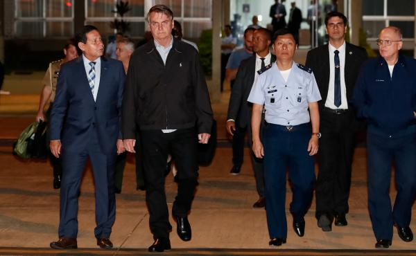 Brazilian President Jair Bolsonaro is calling for severe punishment after 86 pounds of cocaine were found in the luggage of an advance plane for his trip to Japan. Bolsonaro (center) is seen here preparing to leave for this week's G-20 meeting in Osaka.