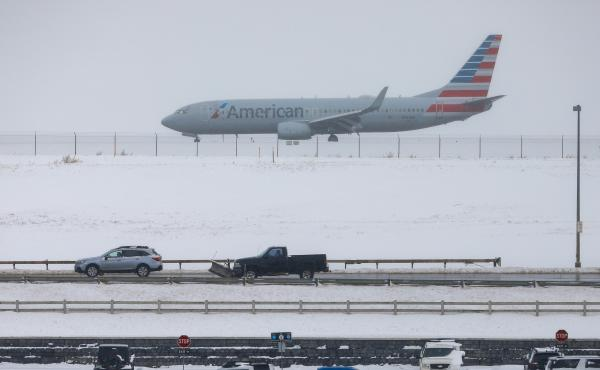 A jet waits for takeoff Tuesday at Denver International Airport, where travelers have seen hundreds of flights canceled amid heavy snow.