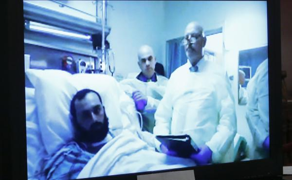 Ahmad Khan Rahimi spoke to an Elizabeth, N.J., court by video from his hospital bed Thursday. He entered pleas of not guilty to charges connected with Sept. 17 bombings in New Jersey and New York.