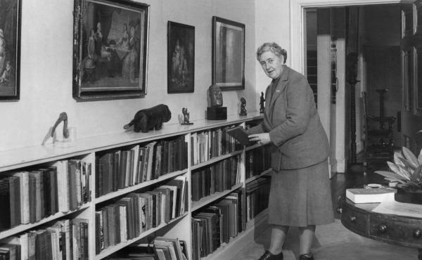 Agatha Christie, seen here in 1946, removes a book from the shelf at Greenway House, the home from which Jennifer Grant bought the trunk six decades later at an estate sale.