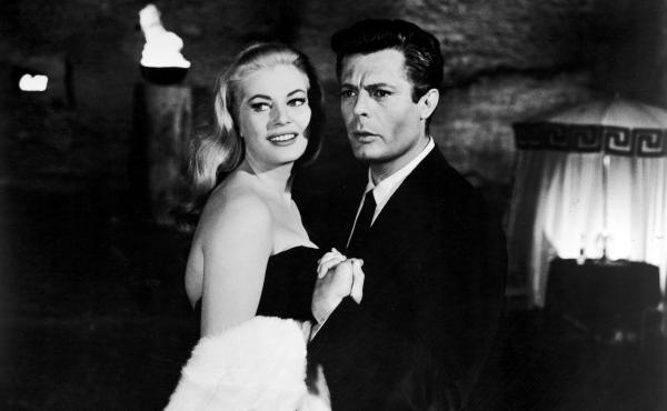 Italian actor Marcello Mastroianni and Swedish actor Anita Ekberg hold hands in a scene from Federico Fellini's 1960 film La Dolce Vita.