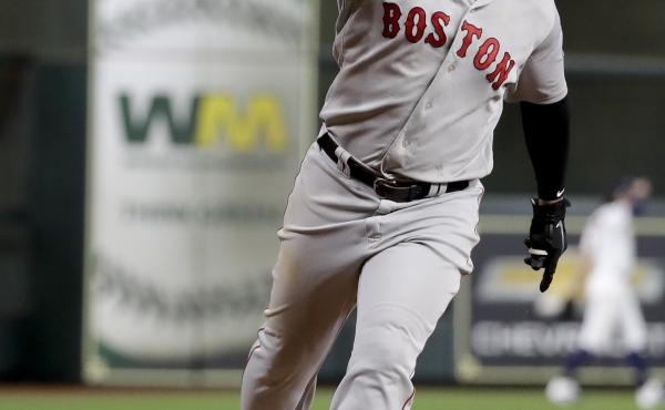 The Boston Red Sox's Rafael Devers celebrates his three-run home run Thursday against the Houston Astros during the sixth inning in Game 5 of the American League Championship Series.