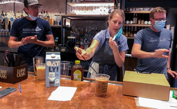 Lauren Moran, a pastry chef who owns a bakery and café, taste-tests Cornwall's new coffee drinks with her husband, Cornwall's general manager Billy Moran (L), and Speedwell Coffee Company owner Derek Anderson.