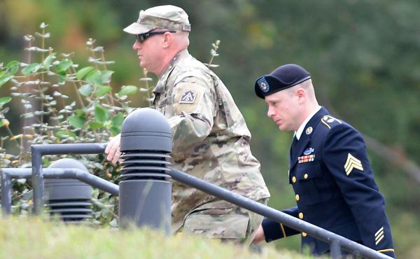 Army Sgt. Bowe Bergdahl (right) was escorted into a military courthouse for a hearing in Fort Bragg, N.C., on Monday.