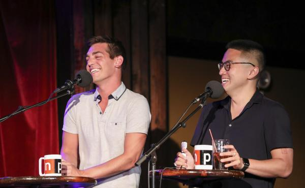Comedians and Las Culturistas hosts Matt Rogers and Bowen Yang face off in a game on Ask Me Another at the Bell House in Brooklyn, New York.