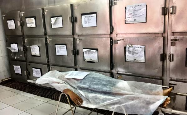 A murder victim at the morgue in the northern Brazilian city of Natal. Brazil has close to 60,000 murders a year, the highest number in the world, according to officials there. Though most victims are shot to death, some lawmakers are pushing to ease gun