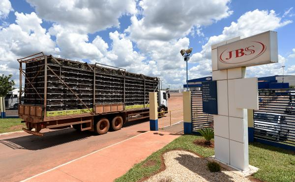 A truck loaded with chickens arrives at a JBS meat processing plant in Samambaia, Brazil, in March.