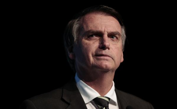 The Brazilian presidential candidate for the Social Liberal Party, Jair Bolsonaro, appears during the Brazilian Sugarcane Industry Association's Unica Forum on June 18, 2018.