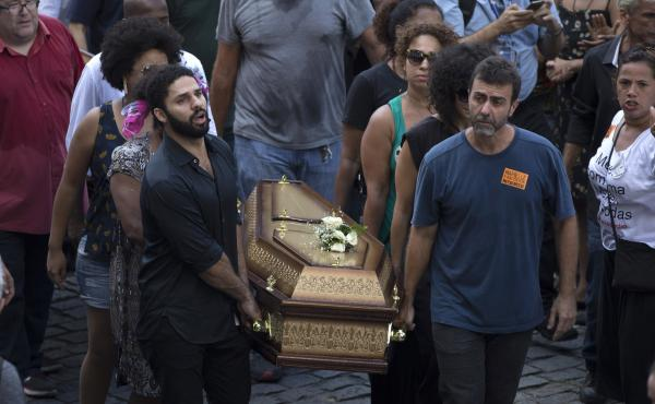 Pallbearers carry coffins containing the remains of Marielle Franco and her driver Anderson Pedro Gomes past a crowd of thousands gathered outside City Hall in Rio de Janeiro on Thursday.