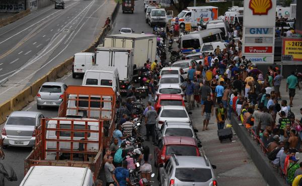 Long, crowded lines extend from a gas station Monday in Rio de Janeiro. For more than a week, a massive truckers' strike has paralyzed fuel and food deliveries across Brazil.