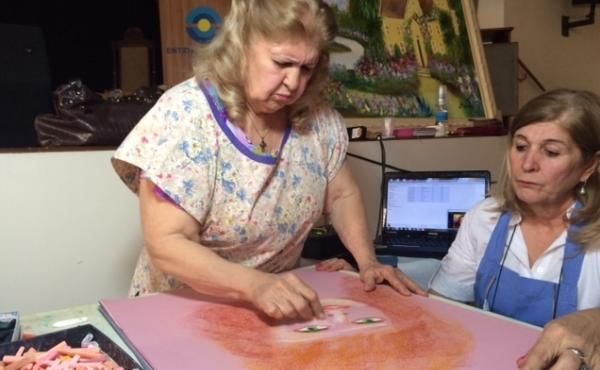 Valdelice Da Silva Dias Salum, 77, says she channels the spirits of famous painters to create her artwork.