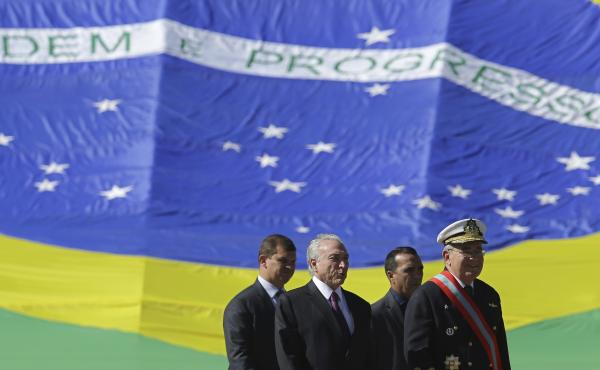 Brazil's President Michel Temer (second from left) arrives Friday to attend a military ceremony, in Brasilia, Brazil.