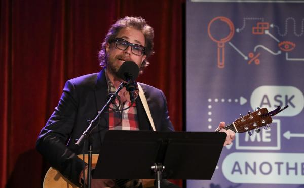 Ask Me Another's house musician Jonathan Coulton leads a music parody game at the Bell House in Brooklyn, New York.