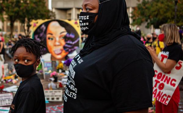 The grand jury recording in the Breonna Taylor case will be released, after a judge ordered the attorney general's office to produce the recording by Wednesday. Here, a mother and son attend a demonstration in what activists are now calling Injustice Squa