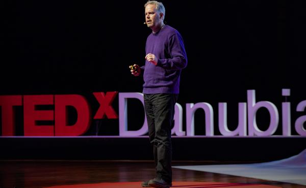 Brett Hennig on the TED stage.