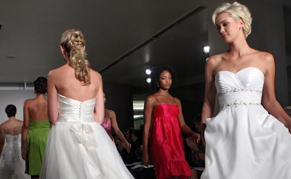Alfred Angelo filed for Chapter 7 bankruptcy after closing dozens of its stories, leaving brides and bridesmaids struggling to get dresses they've paid for. This file photo shows dresses from the company's 2010 season.
