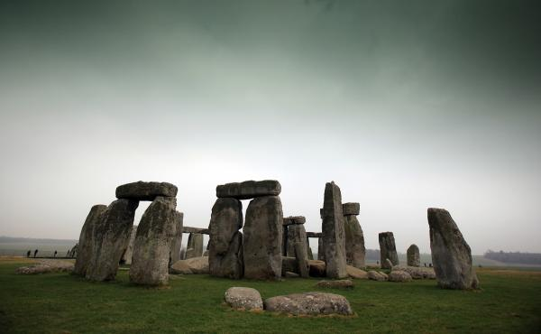 Visitors and tourists walk around the ancient monument at Stonehenge in 2012 in Wiltshire, England.
