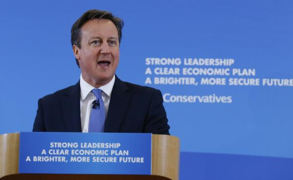 British Prime Minister David Cameron delivers a speech on April 12, 2015 in Cheltenham, England. Britain goes to the polls in a general election on May 7. But campaign slogans and speeches — from Cameron and his rivals — won't carry many references to