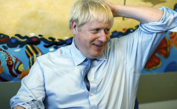 """Britain's Prime Minister Boris Johnson, seen during a visit to a hospital in southwest England on Monday, calls the backstop deal """"inconsistent with the sovereignty of the U.K."""""""