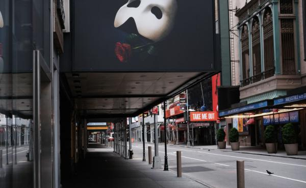 A common street scene in New York's Theater District: a completely empty street, shot on May 6. Broadway theaters will remain shuttered until at least early September.