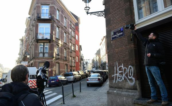 Journalists descended on a street in the Brussels district of Schaerbeek, where police found three belts for possible use in suicide attacks, traces of explosives and a fingerprint of wanted Paris attacks suspect Salah Abdeslam.