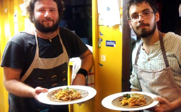 Andris Roder (left) and Adam Finding, cooks at the Kisuzem restaurant in Budapest, prepare a traditional Eritrean meal of injera bread, chickpea paste and meat stew. Their restaurant served up Eritrean food all week for a food festival in solidarity with