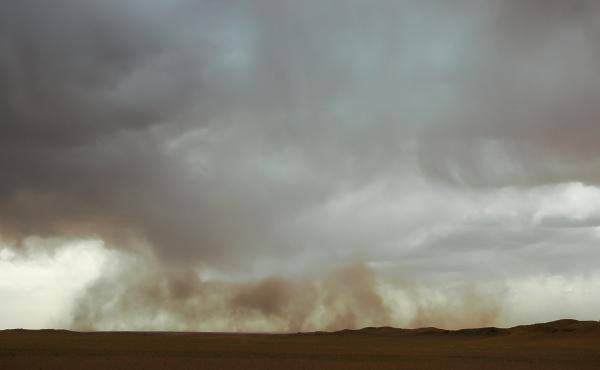 A sandstorm moves the Gobi desert in Mongolia.