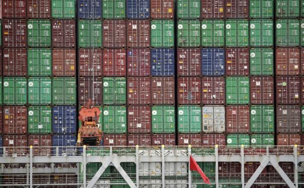 Cargo containers are stacked on a ship at California's Port of Los Angeles. Consumer goods are arriving from China and elsewhere, but a lot is not getting to its destination.