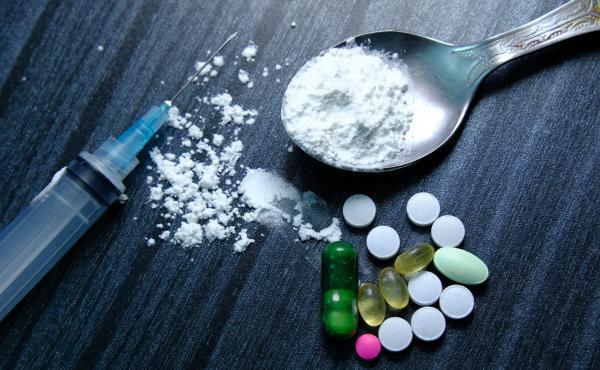 Hard drugs on table.