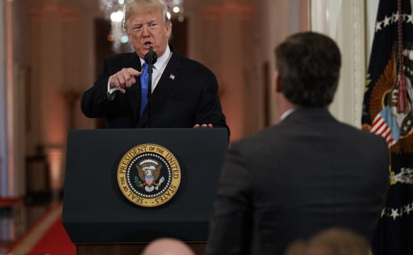 President Trump speaks to CNN journalist Jim Acosta during a news conference at the White House earlier this month.