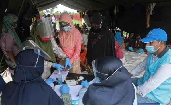 Rohingya refugees at a work training center in Indonesia's Aceh province. Dr. Paul Spiegel of Johns Hopkins University's Center for Humanitarian Health is looking at the data that have been collected on refugees and other vulnerable populations. It's far