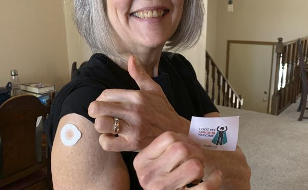 Gloria Anderson receives her second COVID-19 vaccination.