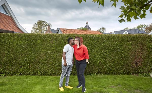 Patrick Phiri of Malawi and fiance Fiona ten Have of Holland kiss in her parents' garden. The couple met in Malawi, where they worked for the same charity, and fell in love. A 3-week visit to the Netherlands turned into 7 months due to pandemic lockdowns