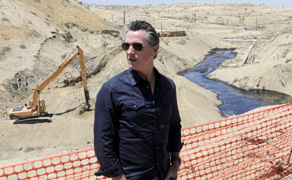 Gov. Gavin Newsom tours the Chevron oil field west of Bakersfield, where a spill of more than 800,000 gallons flowed into a dry creek bed in McKittrick, Calif. in July 2019.