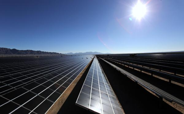Solar cells sit in the sun at the Desert Sunlight Solar Farm in Desert Center, Calif. The people who run California's electric grid expect the solar power output to be cut roughly in half during the eclipse.